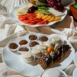 Assortment of fresh fruits and chocolate candies — Stock Photo #11058771
