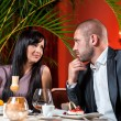 Beautiful couple in love at restaurant — Stock Photo