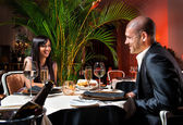 Beautiful couple at restaurant on romantic date — Stock Photo