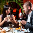 Beautiful couple in love drinking coffee at restaurant — Stock Photo #11081276