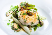Delicious dish with fish fillet, asparagus and herbs on a plate — Stock Photo