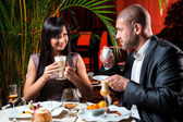 Beautiful couple in love drinking coffee at restaurant — Stok fotoğraf