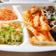 Polystyrene food foam tray with deep-fried potatoes,salads, meat - Stock Photo