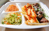 Polystyrene food foam tray with deep-fried potatoes,salads, meat — Foto de Stock