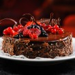 Luscious chocolate cake with fresh berries on a plate — Stock Photo #11330540
