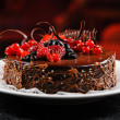 Stock Photo: Luscious chocolate cake with fresh berries on plate