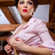 Seductive brunette indoors — Stock fotografie