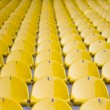 Empty yellow stadium seats — Stock Photo #10911467