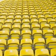 Empty yellow stadium seats — Stock Photo #10911540