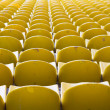 Empty yellow stadium seats — Stock Photo