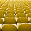 Stock Photo: Empty yellow stadium seats