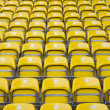 Empty yellow stadium seats — Stock Photo #10911721