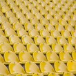 Empty yellow stadium seats — Stock Photo #10911773