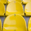 Empty yellow stadium seats — Stock Photo #10911859