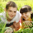 图库照片: Couple lying on grass