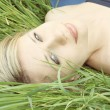 Blonde on grass — Stock Photo