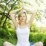 Woman meditating on nature — Stock Photo #10958194