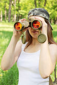 Girl with binoculars — Stock Photo