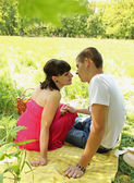 Couple resting on the Glade — Stock Photo