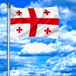 Georgia waving flag against blue sky — Stock Photo