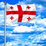 Georgia waving flag against blue sky — Stock Photo #11031981