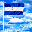 Honduras waving flag against blue sky — Stock Photo