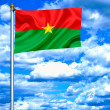Burkina Faso waving flag against blue sky — Stock Photo #11033208