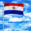 Paraguay waving flag against blue sky — Stock Photo