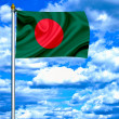 Bangladesh waving flag against blue sky — Stock Photo
