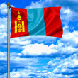Mongolia waving flag against blue sky — Stock Photo