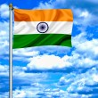 India waving flag against blue sky — Stock Photo
