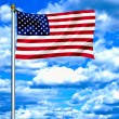 United States of America waving flag against blue sky — Stock Photo