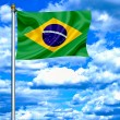 Brazil waving flag against blue sky — Stock Photo