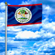 Belize waving flag against blue sky — Photo