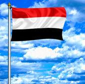 Yemen waving flag against blue sky — Stock Photo