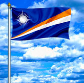 Marshall islands waving flag against blue sky — Stock Photo