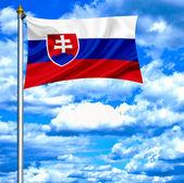 Slovakia waving flag against blue sky — 图库照片