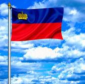 Liechtenstein waving flag against blue sky — Stock Photo