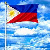 Philippinen waving Flag gegen blauen Himmel — Stockfoto