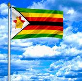 зимбабве, размахивая флагом против голубого неба — Стоковое фото