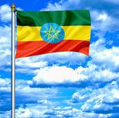 Ethiopia waving flag against blue sky — Stock Photo