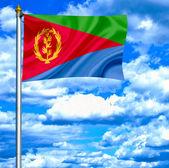 Eritrea waving flag against blue sky — Stock Photo