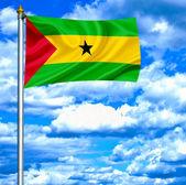 Sao Tome and Principe waving flag against blue sky — Stock Photo