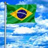 Brazil waving flag against blue sky — Stock Photo