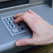 Hand entering numbers on ATM machine — Stock Photo