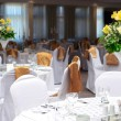 Fancy table set for a wedding with beautiful yellow flowers — Stock Photo #11195329