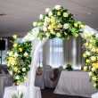 Beautiful wedding flower arch decoration in restaurant — Stock Photo