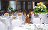 Fancy table set for a wedding with beautiful yellow flowers — Stock Photo