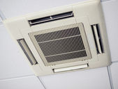 Modern air conditioning system installed on the ceiling — 图库照片