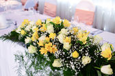 Flower decoration on wedding table — Stock Photo